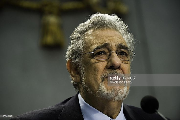 Spanish Tenor Placido Domingo listens to questions during ...