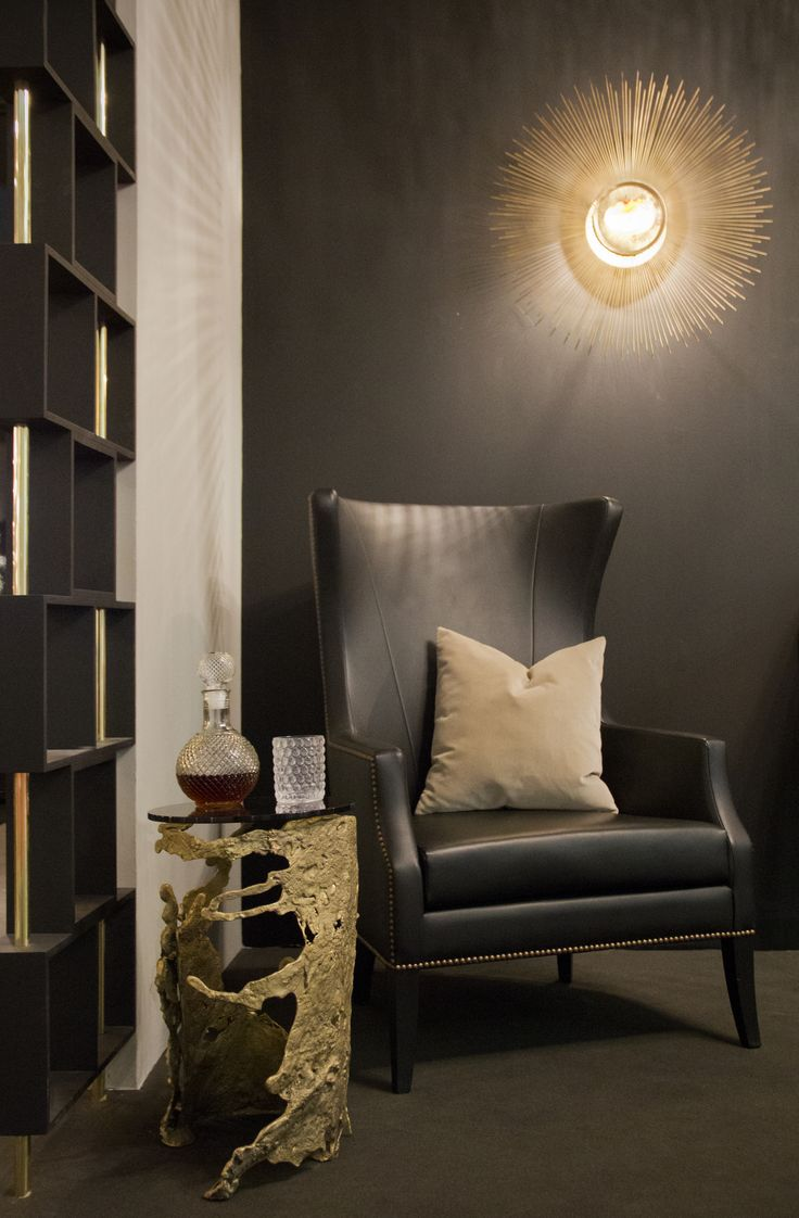 black synthetic leather armchair for a cozy set