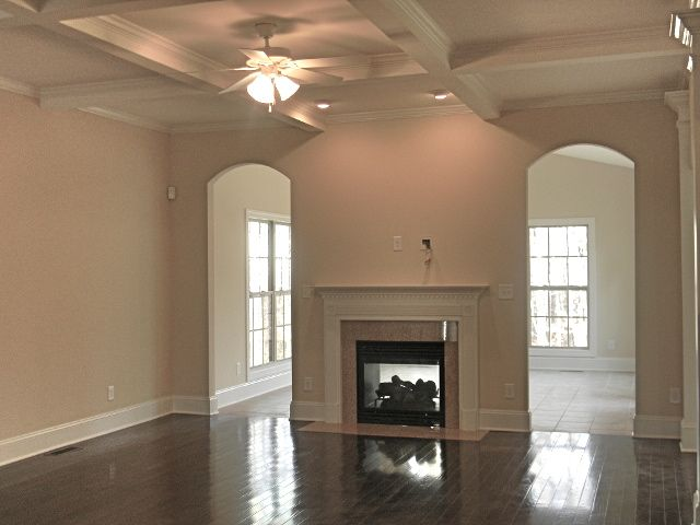 See-through fireplace from family room into sunroom.  Double-sided Wheat Field Granite