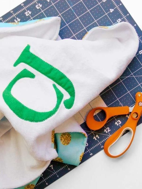 Create the perfect gift for a baby boy or baby girl that coordinates with their nursery theme. We have the complete tutorial to make a monogrammed baby blanket. Click in to learn more.