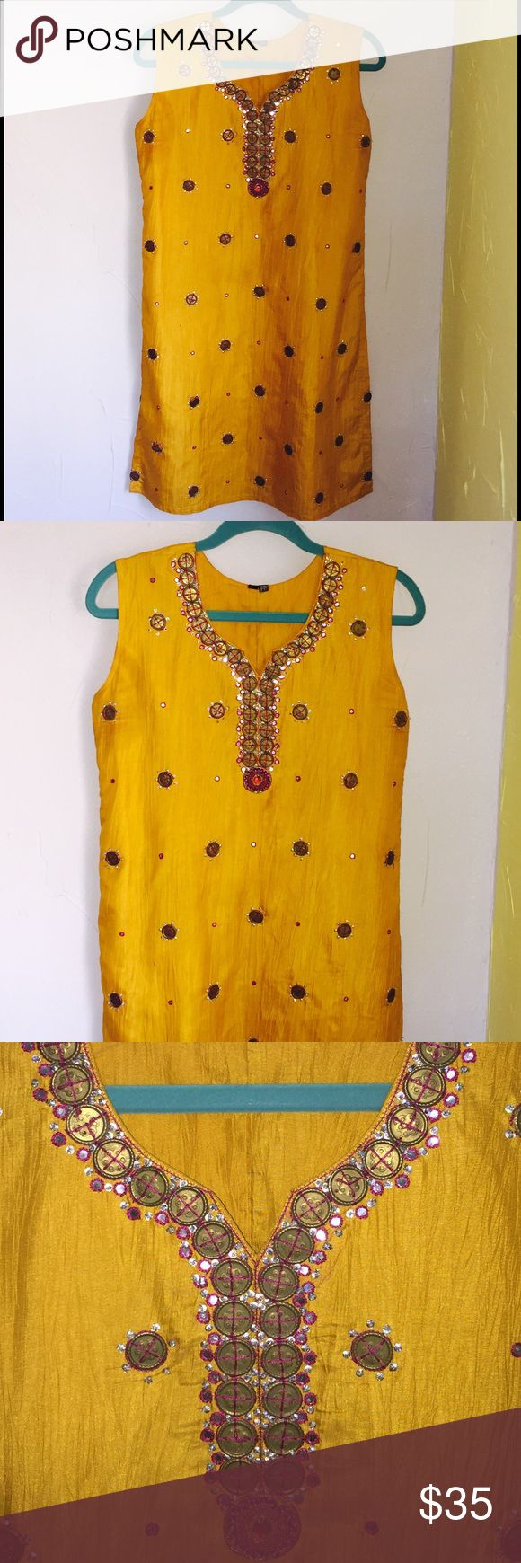 "Silk tunic Mustard yellow silk fully lined sleeve less embellished with metal sequin and beads with thread work bohemian style side slits  length 36"" armpit to armpit 21 waist 19"" hip 21"" arm hole 20"" circumference side slits 13"" will look great with skinny jeans Tops Tunics"