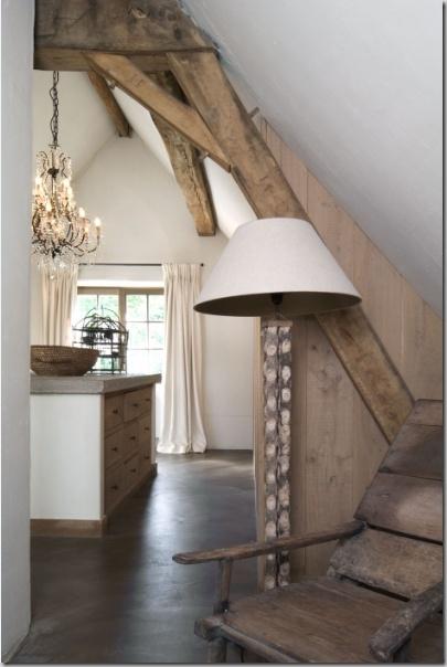 Concrete floors + counter, glass chandelier. Wood. Great warm look.