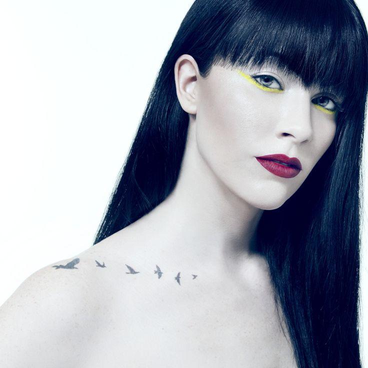 Birds on the collarbone. Audrey Napoleon's tattoo.