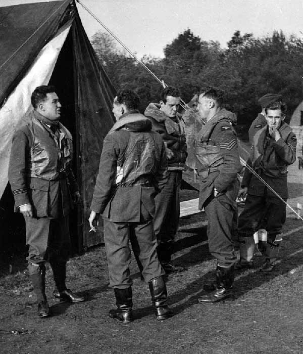 """F/L Norman W Burnett, P/O William B """"Billy"""" Pattullo, P/O Cecil R """"Charlie"""" Young, Sgt Raymond F """"Ray"""" Sellers and Sgt Roger E de Cannart d'Hamale (left to right) of No 46 Squadron RAF wait out at dispersal at RAF Stapleford Tawney in October 1940. On 11 November, whilst on patrol over Foulness, B Flight encountered the CAI of the Regia Aeronautica, of which they destroying at least 8, with no casualties or damage to the unit, scattering the remainder of the enemy formation in disorder."""