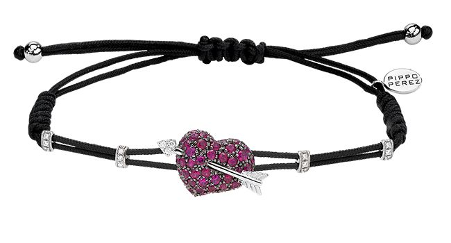 Cellini Jewelers Pippo Perez Ruby Heart and Arrow Set in 18 karat white gold, this bracelet is composed of Rubies and is accented with round brilliants!