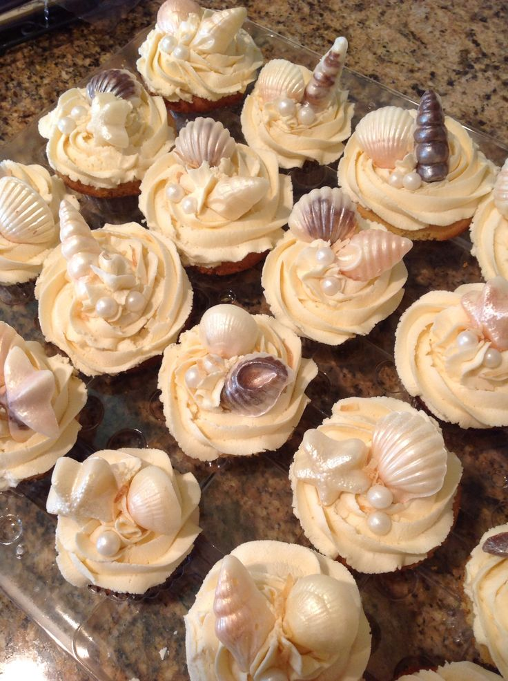 Seaside Cupcakes with White Chocolate Seashells and sugar pearls. Made these for a beach themed wedding.