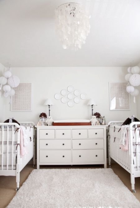 Not this nursery color scheme. Just the set up of the dresser and changing area right in the middle of the two cribs!
