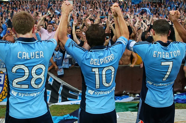 Players and The Cove celebrate Sydney FC's win.