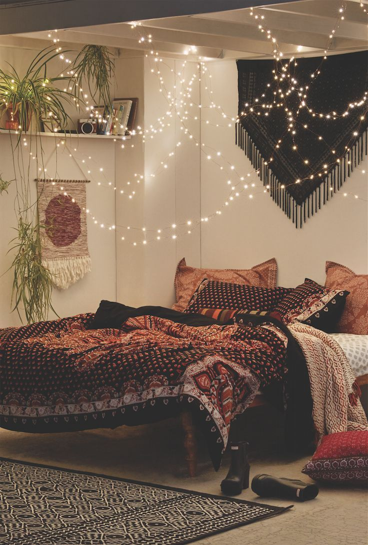 Bohemian Style Bedroom / Hang string lights from your ceiling over your bed, let them drape down low so they're almost like little stars.