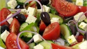 CHORIATIKI  is the real Greek traditional salad, a main course where tomato meets cucumber, green pepper, onion, feta cheese, olive oil and oregano.