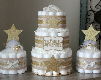These adorable mini cakes are perfect for displaying on a mantle, table décor or simply scattered around your shower. Each cake measures approx. 8 tall and 6 wide - and comes with 10 size 1 Pamper Swaddlers. Available in a variety of sizes. Colors can be changed to match your theme. Toppers are double sided! Need this in a different quantity? Message me for a custom listing, additional mini cakes are $10 each. >>> Other Sizes Options <<< --Lg single tier (20 diapers) --2 tier (27 diapers)…