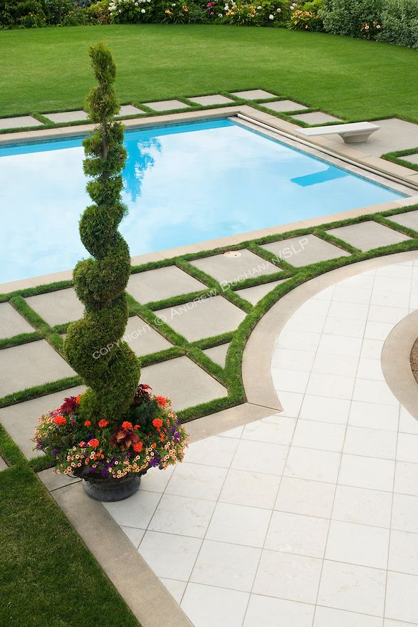 Love the geometric pattern of concrete pavers round the pool area