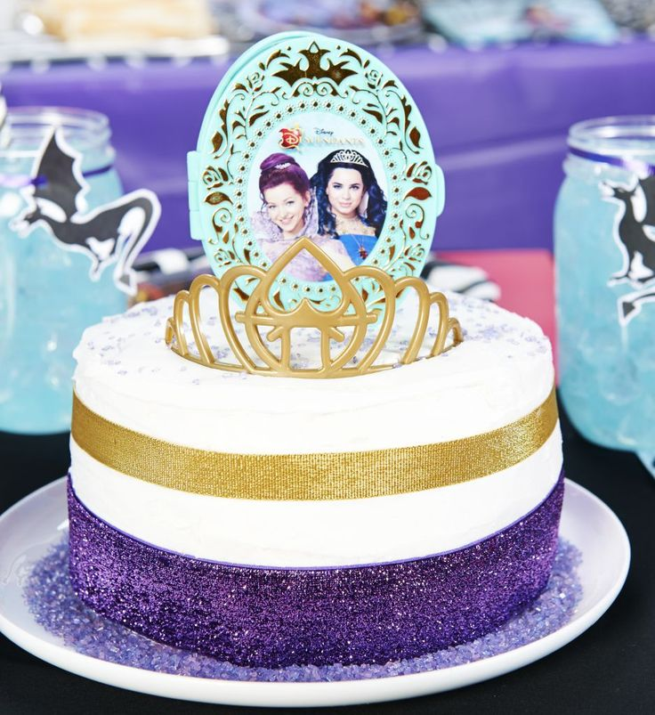Every royal affair, good or evil, needs a beautiful centerpiece. Create a standout cake to be the center of your Disney Descendant's dessert table. Simply decorate your cake in royal colors (purple and gold) and this two-piece cake topper set. This set includes a replica of Mal's coronation crown and a compact featuring Mal and Evie.