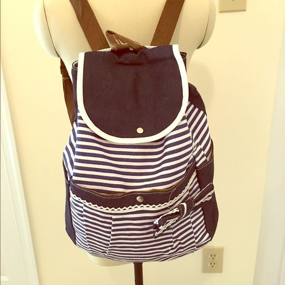 Cute bow blue and white backpack Medium, interior side zipped pocket. Khaki material. Let me know if you have any questions Bags Backpacks