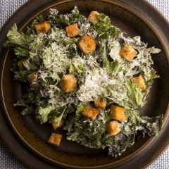 Kale Caesar Salad - Caesar salad is traditionally made with crisp dark leaved Romaine lettuce. Kale has this crisp quality too, making it an excellent vehicle for a crunchy salad. And let's not forget all the additional phytonutrients that this tasty vegetable in the cancer fighting cruciferous family brings to your plate too. All hail Kale Caesar Salad!