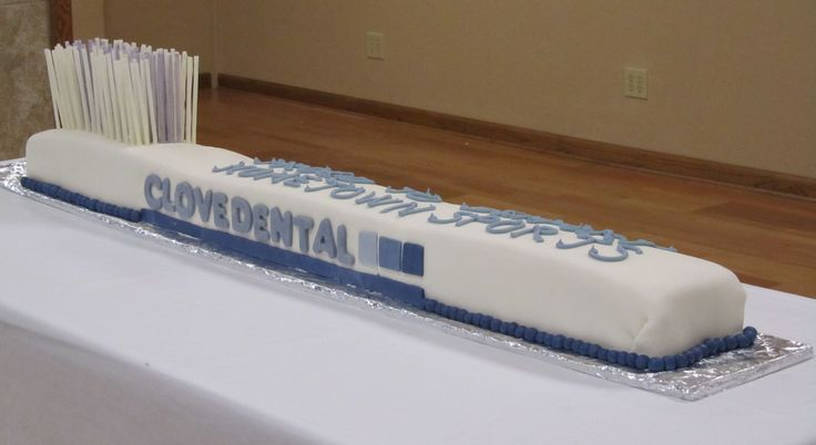 "Dental Toothbrush Cake:  A 6' long Dental Toothbrush Cake!  Clove Dental is ""Proud to Support Hometown Sports""!"