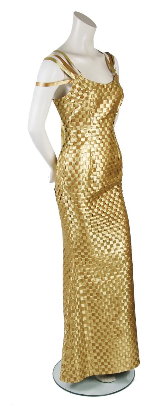 A Todd Oldham Gold Ribbon Evening Gown, 1990s, dress made completely of gold and bronze woven ribbon, ribbon straps, fully lined.