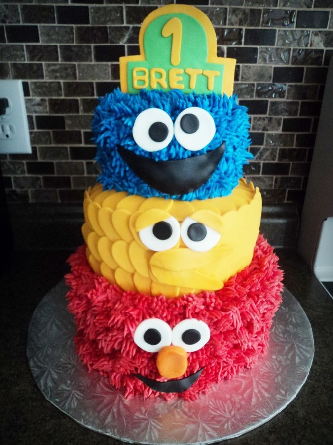 Marble cake with vanilla buttercream! Big Bird's feathers are fondant.