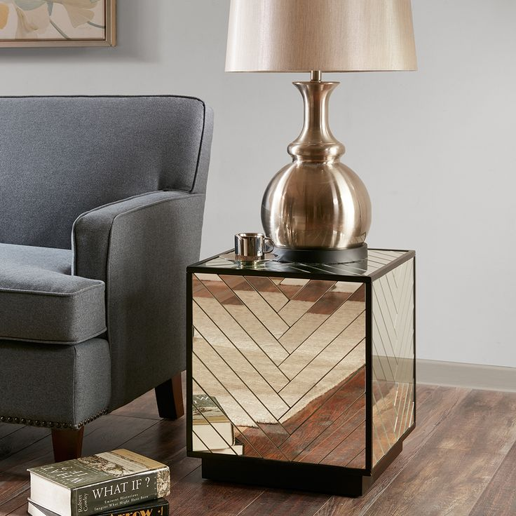 Arrange framed photos and stacked art books on this essential table collection featuring a chevron mirror pattern and contrast ebony finish making it the perfect anchor to any living room. No assembly required