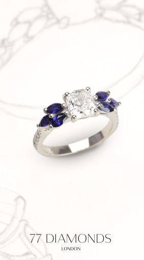 The is a #Bespoke #ring, designed by one of our customers. #Princess center stone partnered with 6 small #Sapphires.