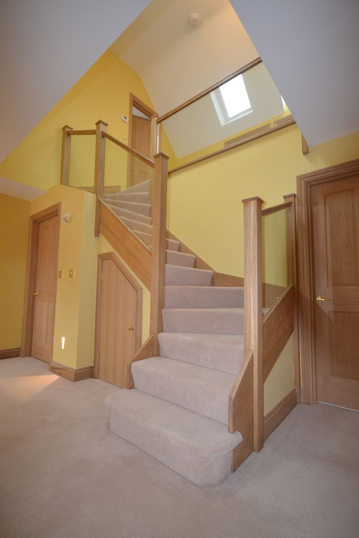 Z shaped staircase handcrafted with light oak wood and glass bannister.