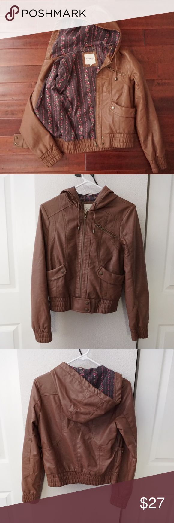Heritage 1981 Brown Leather Look Jacket Measurements taken laying down flat. Size SP. Arm about 23 1/2 in long  Chest about 34 in around Length from shoulder about 21 1/2 in long Good condition. Wear underneath right armpit as shown in pictures. Brown leather look. Zip pocket at the chest. Two pockets on from side. Buttons at bottom. Beautiful floral print interior. Bundle with more items in my closet and save! Heritage 1981 Jackets & Coats