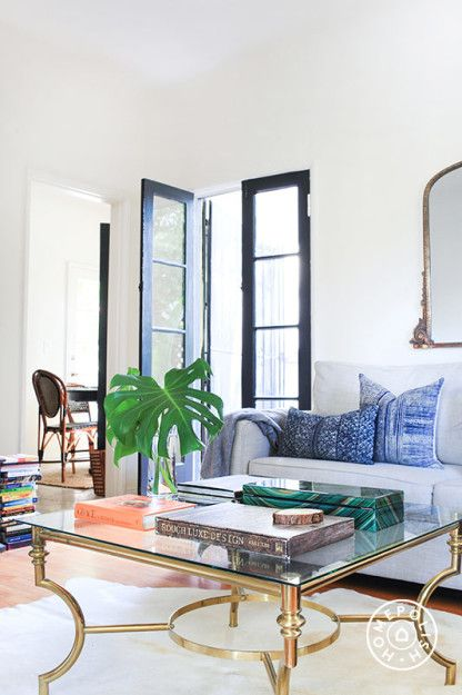 Old World Charm in LA - Wanting to add color to the space while keeping it subdued, Candace chose deep blues to work with the distressed brown leather and add some masculinity to the room. by Homepolish Los Angeles https://www.homepolish.com/mag/old-world-charm-in-la?gallerize=02fcf3ec