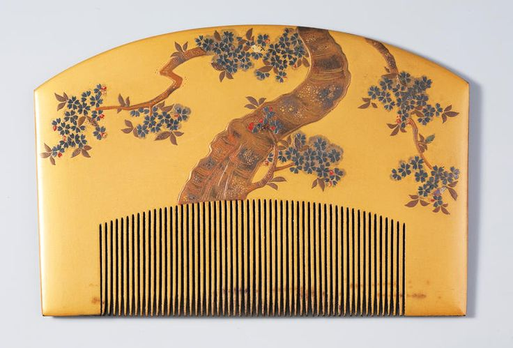 A lacquer comb with maki-e is the canvas for this enamel painting of a tree with blossoms. Signed: Kajikawa. Edo Era.