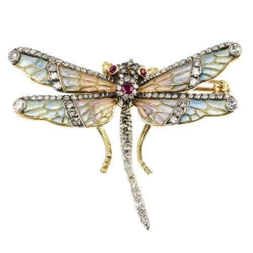 A plique-a-jour enamel dragonfly brooch. The multi-shade plique-a-jour enamel and single-cut diamond wings to the similarly-cut diamond and circular-shape ruby body.