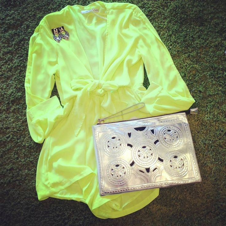 Flashing lights playsuit $20  Greek earrings $15   Silver clutch $25   Total : $61 .