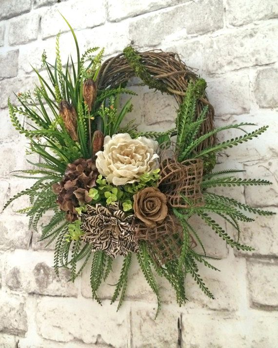Burlap Flower Wreath, Fall Wreath, Front Door Wreath, Grapevine Wreath, Silk Flower Wreath, Etsy - This silk and burlap flower wreath is just breathtaking! What a grand welcome it will bring to your guests at the entrance to your home. It would also make an absolutely gorgeous centerpiece above your mantle or on any interior wall. This beautiful wreath was handmade using a grapevine wreath base wrapped with moss and adorned with a beautiful arrangement of neutral tan, brown, zebra print…