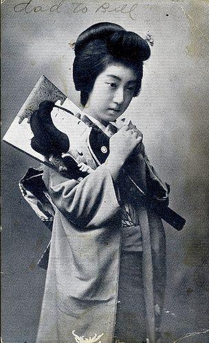 Geisha Teruha with a Hagoita Paddle (1920)
