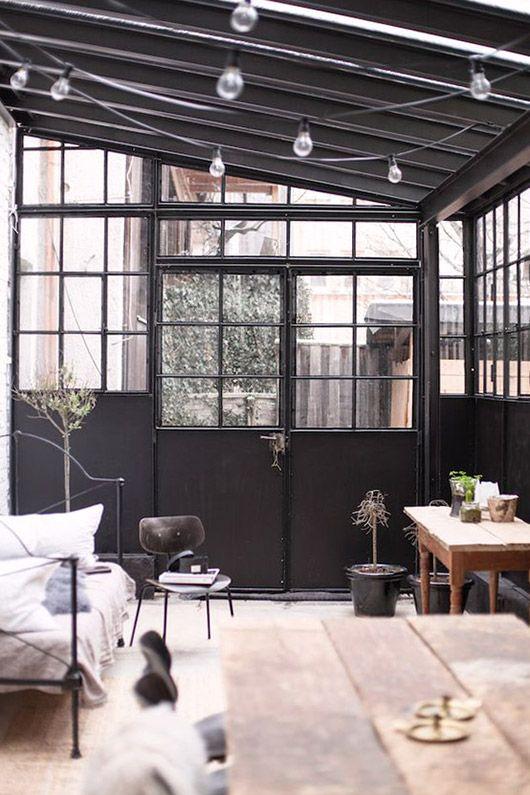 black framed sunroom with minimalist neutral decor. / sfgirlbybay