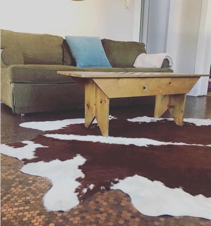 Cactus creek journal cowhide rug on a penny floor