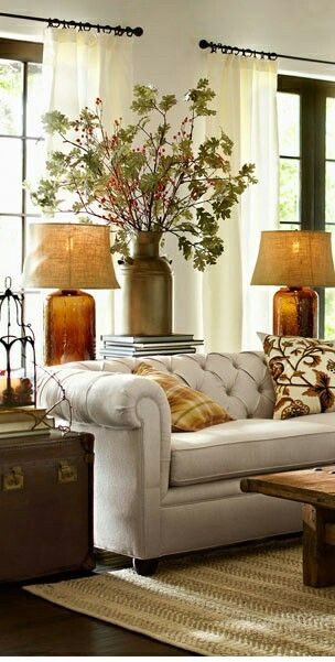Lamps at ends of couch in living room for light on an individual person if needed