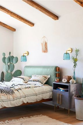Omg that cactus, that bed frame, those light fixtures....