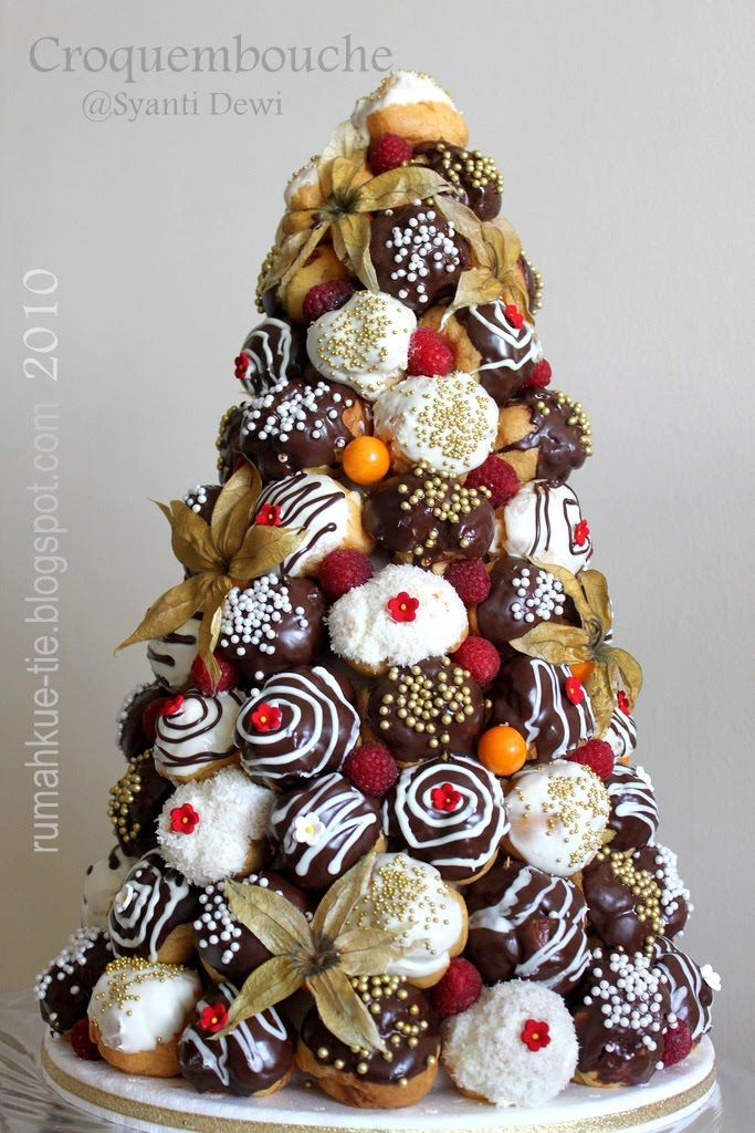 Stunning white and dark chocolate croquembouche with physalis fruits.