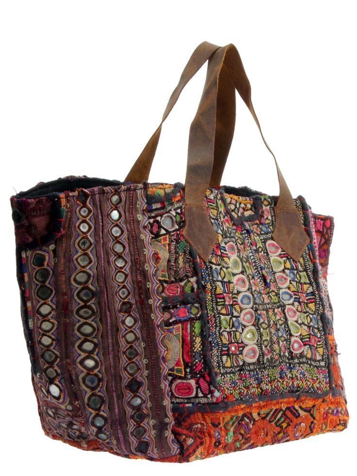 Woven tote bag in mixed fabrics and colors with mirrored disc accents and…