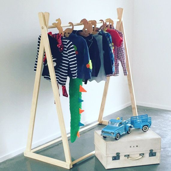 Made out of ecofriendly pine this clothing rack is the perfect addition to any room. It can have many uses. It can be used for displaying the