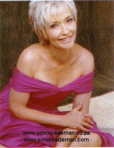 Sonja Herholdt proudly wearing Simon Rademan in Sarie magazine.