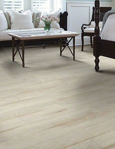 Distressed white hardwood floors can work with any decor -  traditional to beachy. These Anderson Muirs Park Ribbon have a warm feel and lean almost towards an ivory color. Beautiful!
