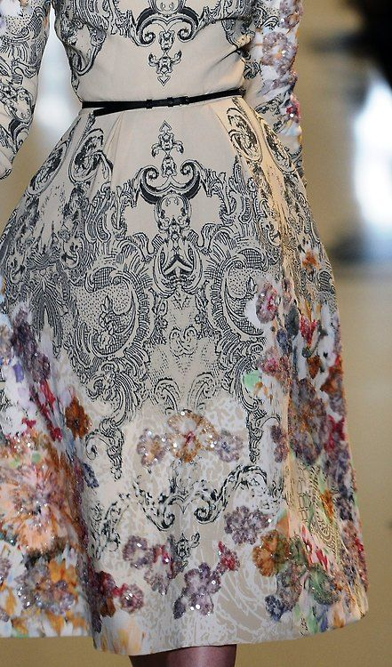 print+broidery - Bold black baroque patterns melted into sherbet-shaded sequins depicting flowers @ElieSaabWorld #Couture