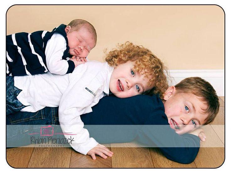 Families. Brothers. Sibling pile up. Rhian Pieniazek Photography.