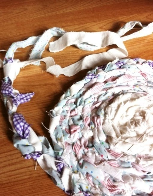 Make a rag rug. These are the rag rugs I remember as a kid. Probably because grandma had so many leftover pieces of fabric!  #crafts #fabric #diy #home