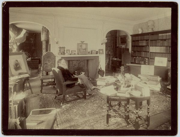 James Russell Lowell in his home library in Massachusetts, late 1800s.