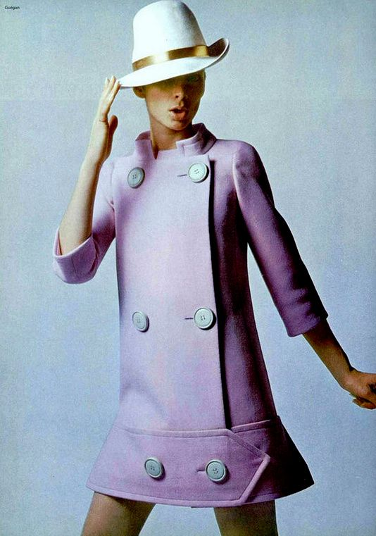 1967 Model in mauve double breasted wool coat, featuring a wide band at the hem ending in a point, by Ted Lapidus