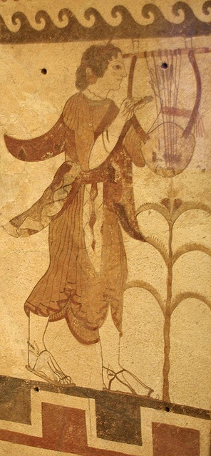 470 BCE. Etruscan, painted fired terra cotta tomb wall decoration. The young female lyre-player. MFA