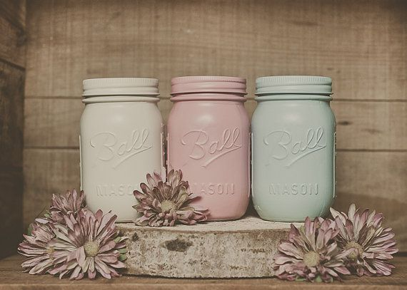 Painted mason jars in pretty pastel colors.  Even the rings are painted, which I wouldn't have thought of.  With rings but sans lids, these would be so nice for flatware. I saw that in Lonny and thought it was a great idea.