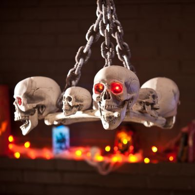 """Battery-operated LED skull chandelier for Halloween, $80.  25""""L x 25""""W x 17""""H.  I feel like I could DIY this from craft store stuff for a lot less..."""
