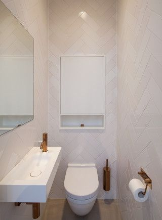 Toilet. Copper faucets, Vola. Private home Amsterdam: interior design and project management by Heyligers design+projects. www.h-dp.nl
